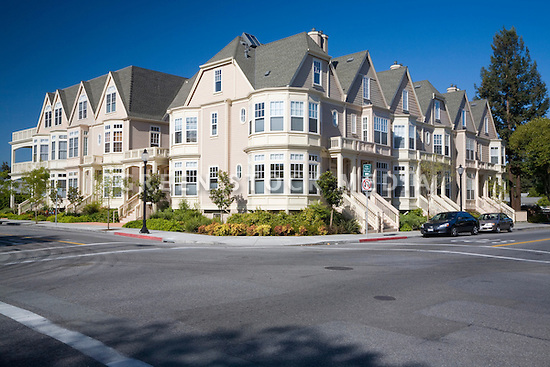 A view of attached housing development one block from downtown Mountain View and close to mass transit options, making the housing very pedestrian friendly. Attached houses allow for more dense development and efficient land use. Mountain View, California, USA