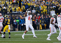Ohio State Buckeyes wide receiver Evan Spencer (6) celebrates after the Buckeyes handled the onside kick during the fourth quarter of the NCAA football game at Michigan Stadium in Ann Arbor, Michigan on Saturday, November 30, 2013. (Columbus Dispatch photo by Jonathan Quilter)