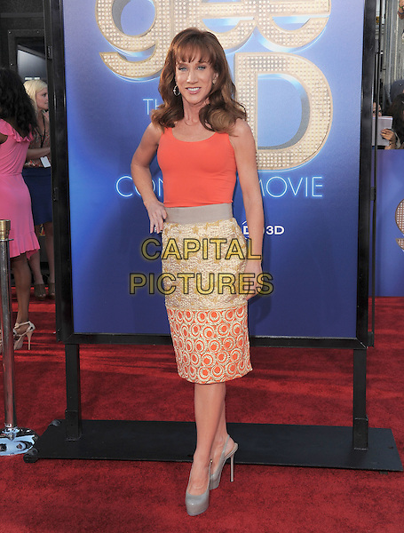 Kathy Griffin .attends The 20th Century Fox 'Glee 3D' Concert World Movie Premiere held at The Regency Village theatre in Westwood, California, USA, .August 6th 2011..full length orange vest top gold skirt dress hand on hip sleeveless grey gray platform shoes patent .CAP/RKE/DVS.©DVS/RockinExposures/Capital Pictures.