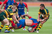 Risiate Tadulala gets upended by Andrew Cameron & Brad Thornton. Counties Manukau Premier Club Rugby game between Ardmore Marist and Pukekohe played at Bruce Pulman Park on Saturday April 17th..Pukekohe won the game 25 - 0 after leading 15 - 0 at halftime.
