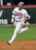 Clemson outfielder Wilson Boyd homers in a game between the Clemson Tigers and Mercer Bears on Feb. 24, 2008, at Doug Kingsmore Stadium in Clemson, S.C. Photo by: Tom Priddy/Four Seam Images