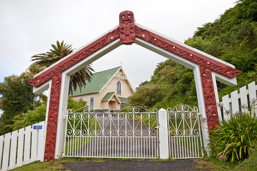 Cultural Syncretism.  Maori Arch in Shape of a Maori Meeting House Welcomes Visitors to St. Mary's Anglican Church, Tikitiki, north island, New Zealand, built 1924-26 as a memorial to Maori soldiers who fought and died in World War I.   A member of the New Zealand Historic Places Trust.  Highway 35, Gisborne Region.