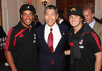 Will Chang owner of DC United flanked by Ronaldinho and Pato of AC Milan at a reception for AC Milan at DAR Constitution Hall in Washington DC on May 24 2010.