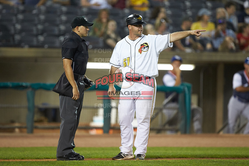 West Virginia Power manager Wyatt Toregas (51) discusses a call with home plate umpire Kelvis Velez during the game against the Lexington Legends at Appalachian Power Park on June 7, 2018 in Charleston, West Virginia. The Power defeated the Legends 5-1. (Brian Westerholt/Four Seam Images)