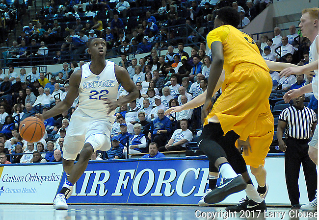 February 4, 2017:  Air Force guard, Pervis Louder #22, advances the ball during the NCAA basketball game between the Wyoming Cowboys and the Air Force Academy Falcons, Clune Arena, U.S. Air Force Academy, Colorado Springs, Colorado.  Wyoming defeats Air Force 83-74.
