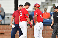 Johnson City Cardinals Mateo Gil (23) is attended to by trainer Justin Wilson and manager Roberto Espinoza (41) during game one of the Appalachian League Championship Series against the Burlington Royals at TVA Credit Union Ballpark on September 2, 2019 in Johnson City, Tennessee. The Royals defeated the Cardinals 9-2 to take the series lead 1-0. (Tony Farlow/Four Seam Images)