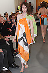 "Model walks runway in an outfit from the ""Comme Des Marxists"" collection by artist Rainer Ganahl for his fashion show at White Columns art gallery during PERFORMA 13, on November 4, 2013."