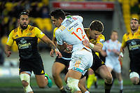 Beauden Barrett tackles Anton Lienert-Brown during the Super Rugby semifinal match between the Hurricanes and Chiefs at Westpac Stadium, Wellington, New Zealand on Saturday, 30 July 2016. Photo: Dave Lintott / lintottphoto.co.nz