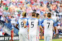 Kansas City, KS. - May 28, 2016: Players congratulate Gyasi Zardes on his opening goal. The U.S. Men's national team defeated Bolivia 4-0 in an international friendly tuneup match prior to the opening of the 2016 Copa America Centenario at Children's Mercy Park.
