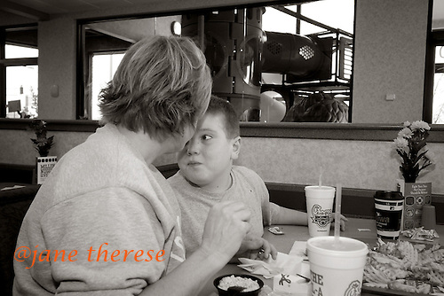 Drew McDowell 10 of Souderton, Pa., vies for his mother's attention while out to lunch at Chick-filet in Haddonfield, NJ on Wednesday November 15, 2006. Drew who is visiting his brother Danny 15 is also severely autistic. This is the first time the boys have seen each other since July 6, 2006. Danny does not live at home but at Bancroft in Haddonfield, NJ because his behavior was self abusive and he could not be managed. Danny needs constant attention and with two boys afflicted, it is very stressful and demanding for both parents, Jill and Stacy. Photo by Jane Therese