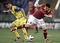 Calcio, Serie A: Roma vs Chievo Verona, Stadio Olimpico, Roma, 7 maggio  2013..ChievoVerona midfielder Perparim Hetemaj, of Finland, and AS Roma forward Mattia Destro, right, fight for the ball during the Italian serie A football match between Roma and ChievoVerona at Rome's Olympic stadium, 7 maggio  2013..UPDATE IMAGES PRESS/Isabella Bonotto
