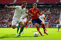 01.08.2012 Manchester, England. Morocco defender Mohamed Abarhoun and Spain defender Jordi Alba  in action during the third round group D mens match between Spain and Morocco at Old Trafford.