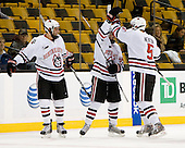 David Strathman (NU - 6), Tyler McNeely (NU - 94), Jake Newton (NU - 5) - The Northeastern University Huskies defeated the Harvard University Crimson 4-1 (EN) on Monday, February 8, 2010, at the TD Garden in Boston, Massachusetts, in the 2010 Beanpot consolation game.