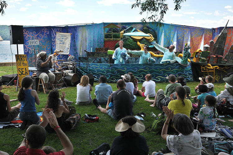 """From left to right- Patrick Wadden, Dale Gibbons, and Carl Weldon take a bow at the end of the performance by Arm-of-the-Sea Theater of the play, """"CITY that DRINKS the MOUNTAIN SKY,"""" performed at the edge of the Hudson River during the 2012 Clearwater Festival at Croton Point Park on Saturday, June 16, 2012. Photograph taken by Jim Peppler. Copyright Jim Peppler/2012"""