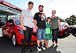 "Daniel McNicholl and family Mischa Harris and Whitney Harris (R) with Holden Ambassador Greg Murphy  in front of their new Holden Barina. Holden New Zealand, ""Mullet Amnesty Day"", trade your mullet for a Holden Astra, West City Holden, Auckland, New Zealand, Saturday 1st April 2017. Photo: Simon Watts/www.bwmedia.co.nz"