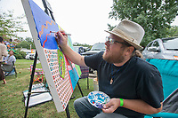 NWA Democrat-Gazette/J.T. WAMPLER Shane Baskins of Maumelle paints with acrylic during the Terra Studios Fall Music and Art Festival Sunday Sept. 9, 2018. The festival included song circles, heritage folk arts, local craft vendors, live art demonstrations and food trucks. More than 500 people attended the event. For more information about Terra Studios visit www.terrastudios.com