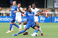 Chesterfield's Mike Fondop-Talom falls to the ground after a challenge from Bromley's Marc-Anthony Okoye during Bromley vs Chesterfield, Vanarama National League Football at the H2T Group Stadium on 7th September 2019