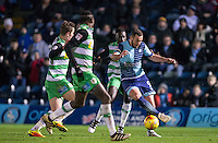 Paul Hayes of Wycombe Wanderers takes on Yeovil defenders during the Sky Bet League 2 match between Wycombe Wanderers and Yeovil Town at Adams Park, High Wycombe, England on 14 January 2017. Photo by Andy Rowland / PRiME Media Images.