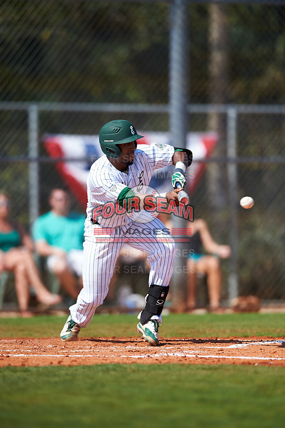 Eastern Michigan Eagles shortstop Marquise Gill (4) lays down a bunt during a game against the Dartmouth Big Green on February 25, 2017 at North Charlotte Regional Park in Port Charlotte, Florida.  Dartmouth defeated Eastern Michigan 8-4.  (Mike Janes/Four Seam Images)