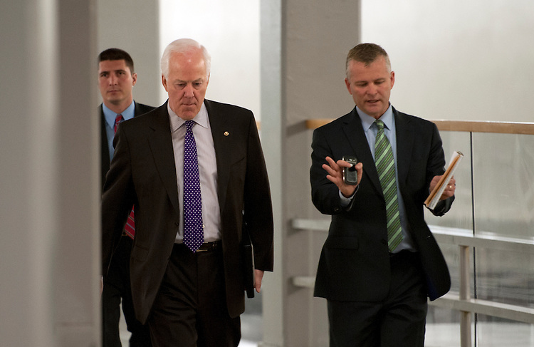 UNITED STATES - May 15: Sen. John Cornyn, R-TX., walks with staff and a security detail to the U.S. Capitol through the Senate subway tunnel on May 15, 2013. (Photo By Douglas Graham/CQ Roll Call)