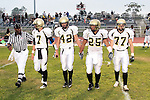 Culver City, CA 09/17/10 - Brock Dale (Peninsula #7), Haden Gregory (Peninsula #42), Logan Okuda (Peninsula #25) and Blake Allman (Peninsula #77) approach midfield for the coin toss at the start of the game.