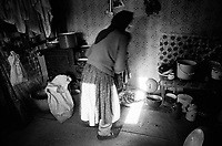 ROMANIA / Maramures / Manastirea Giulesti / March 2003..An old woman's kitchen in this tiny village along the Mara valley of Maramures. Her traditional peasant shoes are called opinchi, and until recently, both young and old people wore them every day...© Davin Ellicson / Anzenberger..