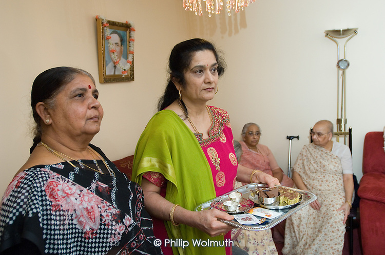 Gujarati presentation ceremony organised by tenant Lakshmibehn Rabheru in her flat on Rayners Lane Estate, Harrow for Home Housing's Estate Manager Pamela da Costa.