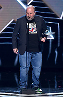 "LOS ANGELES - DECEMBER 6: Aaron Greenberg accepts the Best Sports/Racing Game award for ""Forza Horizon 4"" (Playground Games / Turn 10 Studios / Microsoft Studios) at the 2018 Game Awards at the Microsoft Theater on December 6, 2018 in Los Angeles, California. (Photo by Frank Micelotta/PictureGroup)"