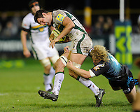 Calum Clark of Northampton Saints (left) is tackled by Duncan Jones of Ospreys during the LV= Cup second round match between Ospreys and Northampton Saints at Riverside Hardware Brewery Field, Bridgend (Photo by Rob Munro)