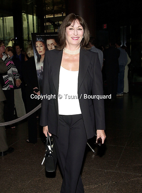 Angelica Huston arriving at the premiere of Mist of Avalon at the Director Guild of America in Los Angeles. The Mist of Avalon is the legendary story of Camelot seen through the eyes of the women who wielded power behind King Arthur throne. June 25, 2001  © Tsuni          -            HustonAngelica03.jpg