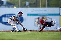Auburn Doubledays second baseman Max Schrock (9) waits for a throw as Giovanny Alfonzo (8) slides in during a game against the Batavia Muckdogs on July 10, 2015 at Dwyer Stadium in Batavia, New York.  Auburn defeated Batavia 13-1.  (Mike Janes/Four Seam Images)