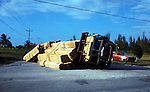 Overturned lorry with timber on the road. Jamaica circa 1976