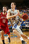 BROOKINGS, SD - MARCH 1:  Brayden Carlson #12 from South Dakota State University eyes the basket while driving past Adam Thoseby #13 from the University of South Dakota in the second half or their game Saturday afternoon at Frost Arena in Brookings. (Photo by Dave Eggen/Inertia)