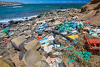 plastics and other marine debris, blown onto the eastern beaches of Hawaiian islands by strong trade wind, after circulating the world of ocean for years, Molokai, Hawaii, USA, Pacific Ocean