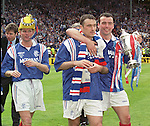 Ian Durrant, Ian Ferguson and Alan McLaren parade the Scottish Cup in 1996 after a 5-1 victory over Hearts at Hampden. Super Ally is suited up at the rear