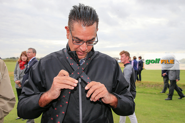 Akshay Bhatia (USA) having his tie dune up by his dad during the opening ceremony at the Walker Cup, Royal Liverpool Golf CLub, Hoylake, Cheshire, England. 06/09/2019.<br /> Picture Fran Caffrey / Golffile.ie<br /> <br /> All photo usage must carry mandatory copyright credit (© Golffile | Fran Caffrey)