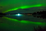 Northern lights reflect on Kashwitna Lake, Southcentral Alaska, Autumn.