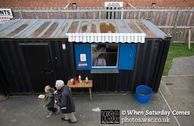 Cefn Druids AFC 1 Buckley Town 0, 12/04/2014. The Rock, Cymru Alliance league. A man and boy buying refreshments at The Rock, Rhosymedre, home to Cefn Druids AFC, prior to the club's final home game of the season against Buckley Town in the Cymru Alliance league. Druids, reputedly the oldest football club in Wales, won the Alliance league the previous week and were awarded the trophy after the Buckley Town match, which they won by 1 goal to nil, watched by a crowd of 246. The Cymru Alliance was the second tier of Welsh football based in north and mid Wales, promotion from which led directly into the Welsh Premier League. Photo by Colin McPherson.