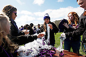 Northwestern themed sunglasses are distributed to freshmen in Wildcat Alley before the game against South Dakota.