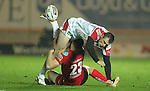 Ulster replacement wing Tommy Bowe loses the ball as his opposite number Adam Warren makes the tackle..Celtic League.Scarlets v Ulster.Parc y Scarlets.02.12.12..©Steve Pope