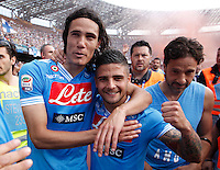 Napoli's Edinson Cavani  and lorenzo Insigne celebrates victory and the qualification of the SSC Napoli team in the UEFA Champions League during the Italian Serie A football match between SSC Napoli and Siena at the San Paolo stadium in Naples.NAPOLI CACIO FESTA QUALIFICAZIONE  CHAMPIONS