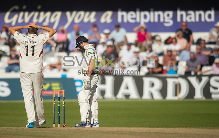 Picture by Allan McKenzie/SWpix.com - 26/09/2014 - Cricket - LV County Championship Div One - Yorkshire County Cricket Club v Somerset County Cricket Club - Headingley Cricket Ground, Leeds, England - Somerset's Jamie Overton is exasperated as Yorkshire's Richard Pyrah see's the ball resting on the stumps after a delivery.