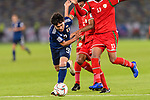 Minamino Takumi of Japan (L) is tackled by Mohammed Al Musallami, Harib Al Saadi and Khalid Al Braiki of Oman during the AFC Asian Cup UAE 2019 Group F match between Oman (OMA) and Japan (JPN) at Zayed Sports City Stadium on 13 January 2019 in Abu Dhabi, United Arab Emirates. Photo by Marcio Rodrigo Machado / Power Sport Images