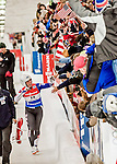 5 December 2015: Erin Hamlin, competing for the United States of America, is elated as she greets fans after her second run of the Viessmann World Cup Women's Luge. With a combined 2-run time of 1:27.961, and a track record on her first run, Hamlin takes the first place finish at the Olympic Sports Track in Lake Placid, New York, USA. Mandatory Credit: Ed Wolfstein Photo *** RAW (NEF) Image File Available ***