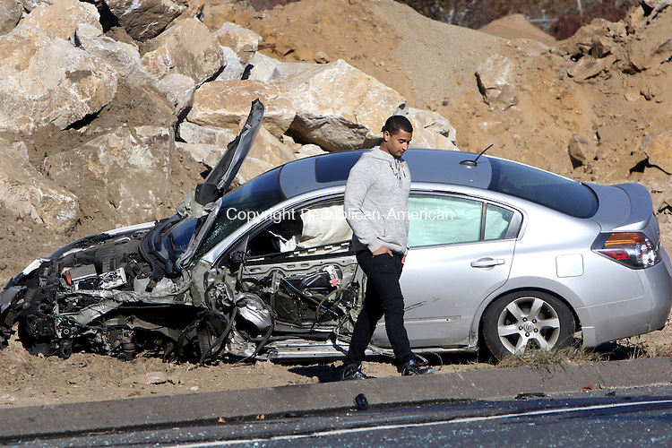WATERBURY CT. 23 October 2015-102315SV02-A silver vehicle involved in an accident sits along side Watertown Avenue in the are of Municipal Stadium in Waterbury Friday.<br /> Steven Valenti Republican-American