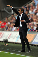 Manager of Chelsea, Antonio Conte shouts instructions to their players during the Premier League match between Swansea City and Chelsea at The Liberty Stadium on September 11, 2016 in Swansea, Wales.