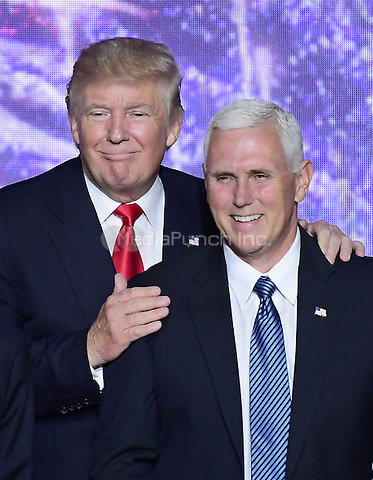 Donald J. Trump and Governor Mike Pence (Republican of Indiana) after Trump delivered his acceptance speech as the GOP candidate for President of the United States at the 2016 Republican National Convention held at the Quicken Loans Arena in Cleveland, Ohio on Thursday, July 21, 2016.<br /> Credit: Ron Sachs / CNP/MediaPunch<br /> (RESTRICTION: NO New York or New Jersey Newspapers or newspapers within a 75 mile radius of New York City)
