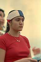 Teen age 15 at Cinco de Mayo wearing Puerto Rican headband.  St Paul Minnesota USA
