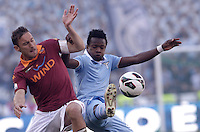 Calcio, finale di Coppa Italia: Roma vs Lazio. Roma, stadio Olimpico, 26 maggio 2013..AS Roma forward Francesco Totti, left, and Lazio midfielder Ogenyi Onazi, of Nigeria, fight for the ball during the Italian Cup football final match between AS Roma and Lazio at Rome's Olympic stadium, 26 May 2013..UPDATE IMAGES PRESS/Isabella Bonotto....