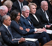 Former first lady Michelle Obama, second left, puts her hand on the arm of former US President Bill Clinton, center, as he gets emotional during the eulogies to former US President George H.W. Bush during the National funeral service in honor of the late former President at the Washington National Cathedral in Washington, DC on Wednesday, December 5, 2018.  Also pictured are former US President Barack Obama, left, former US Secretary of State Hillary Rodham Clinton, second right, and former US President Jimmy Carter<br /> Credit: Ron Sachs / CNP<br /> (RESTRICTION: NO New York or New Jersey Newspapers or newspapers within a 75 mile radius of New York City)